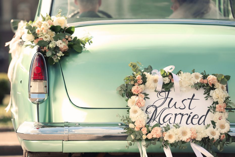 Turquoise car with just married sign on back
