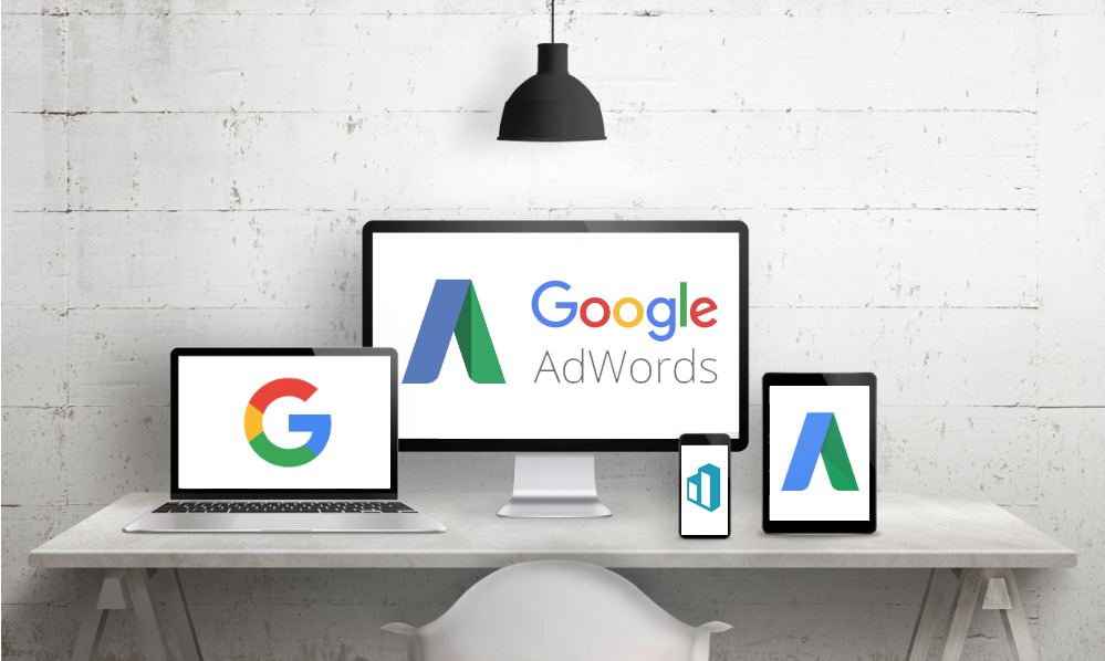 Assorted computer screens with Google AdWords logo displaying