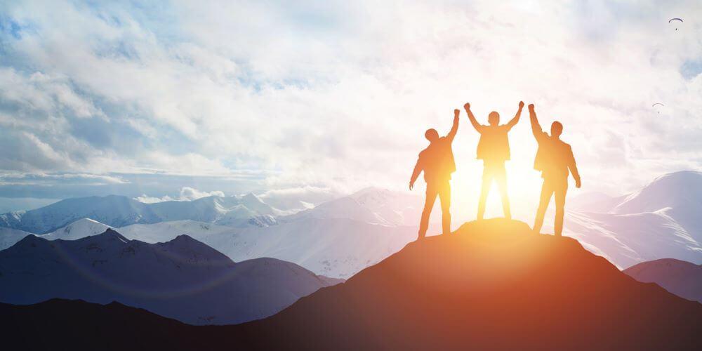 Teamwork on top of mountain