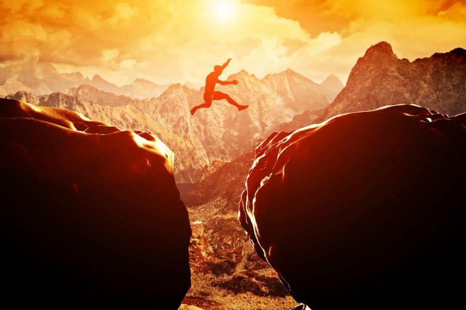 man leaping towards business success
